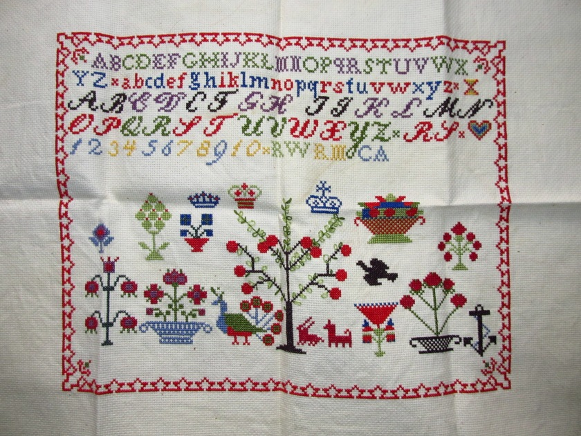 My first completed sampler, circa 1994. Please excuse the awful creases!