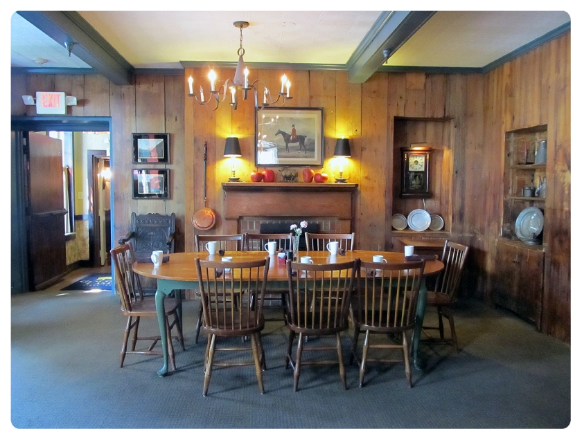 The large table at the end of the room. The door leads into the current Black Horse Tavern.